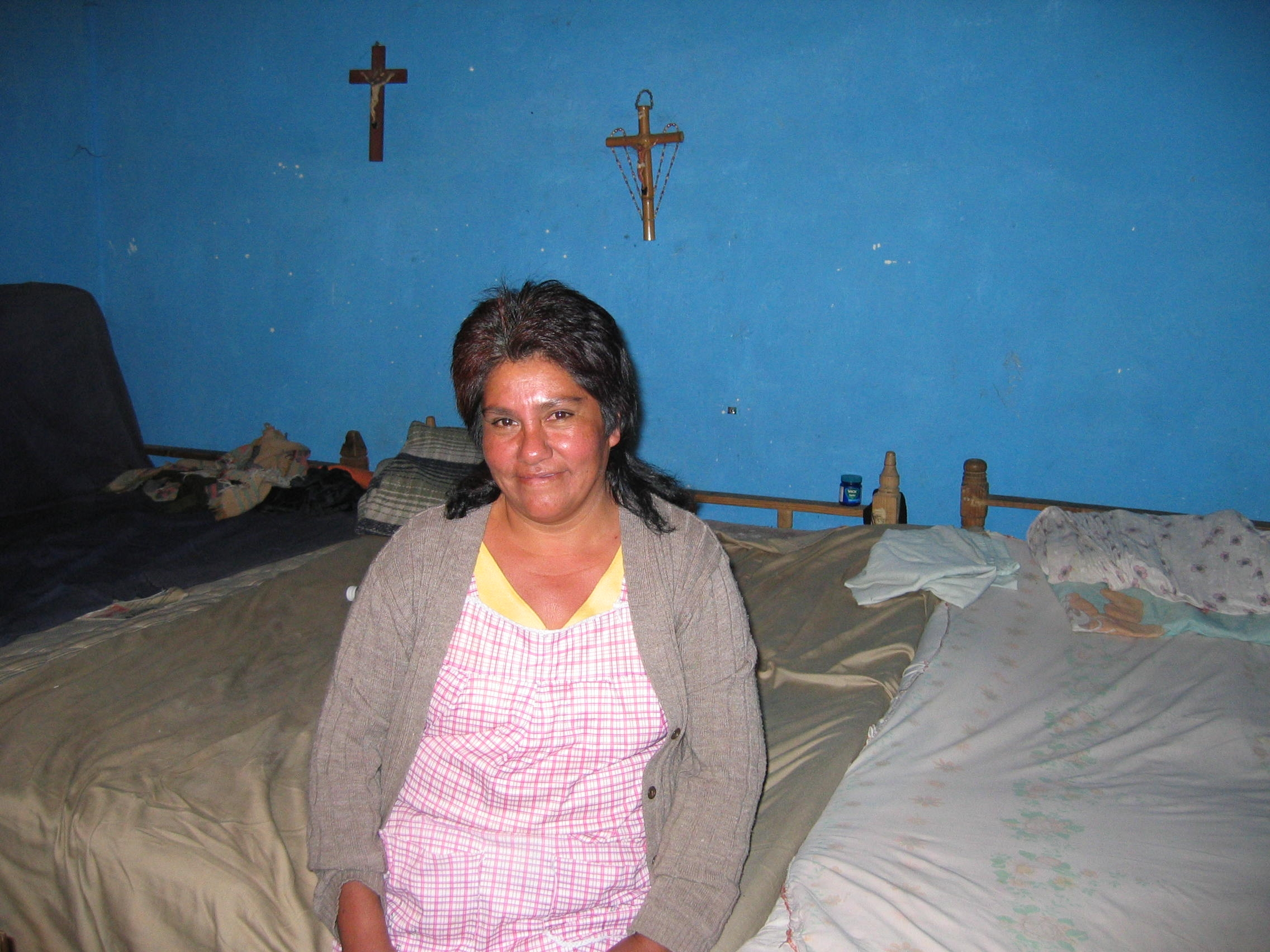 Francisca Aguirre Juárez allows tired migrants to sleep in her one-room home. In two years, 80 migrants have slept in her home, which is so cramped that three beds are shoved together.