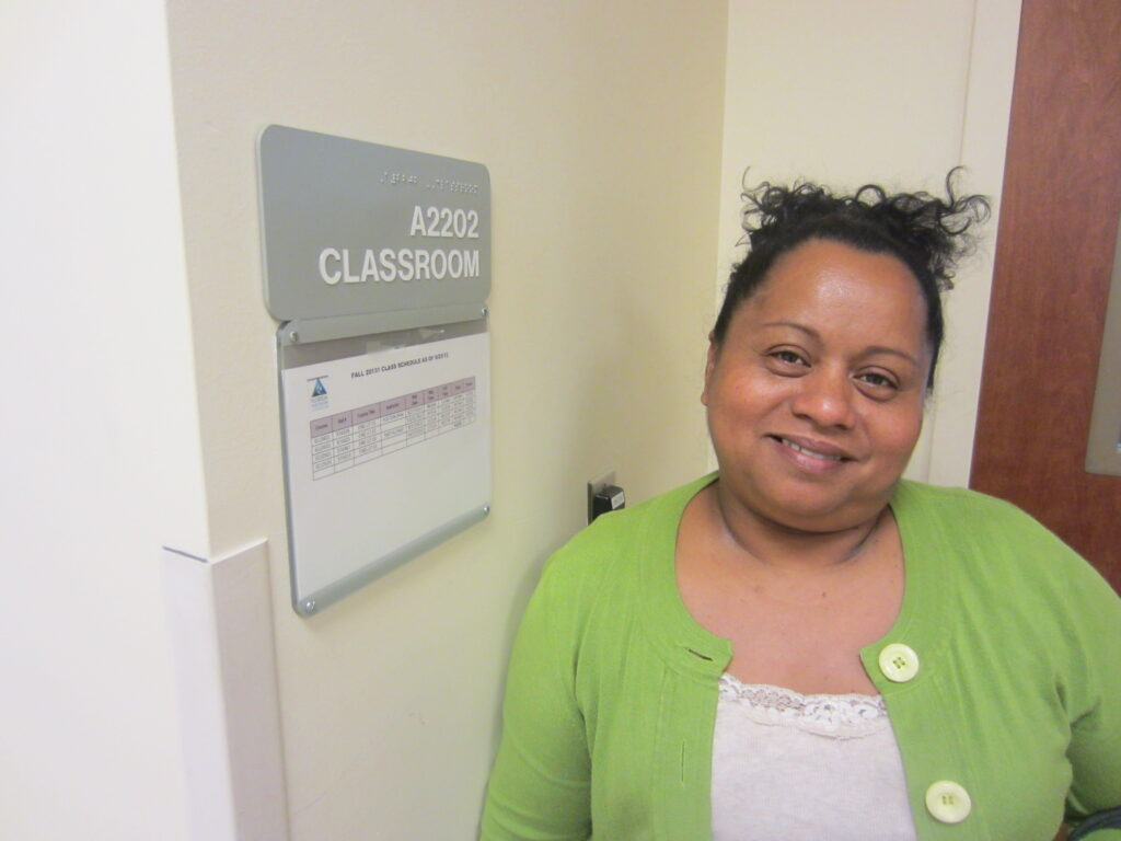 Lourdes in 2013 stands outside the college classroom in Jacksonville, Florida, where she studies four nights a week in her quest to earn a GED. [Credit: Sonia Nazario]