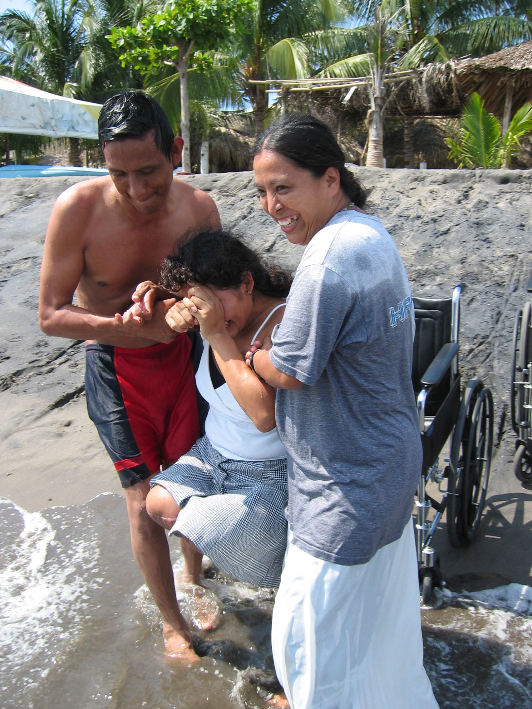 Olga Sánchez Martínez and a shelter volunteer take injured migrants to the beach. For many migrants, it is the first time they have seen an ocean.