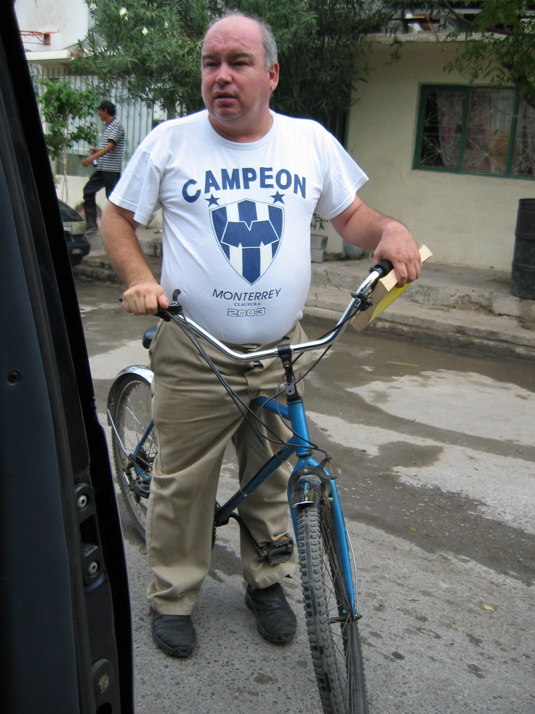"At the Parroquia San José in Nuevo Laredo, Mexico, Father Leonardo López Guajardo uses a rickety blue bike to pick up donated food and clothing for migrants. The humble priest uses the bike instead of a car and says: ""Either we are with the poor, or we are not. God teaches us to most help the poor."" To him, the people most in need in his city are migrants."