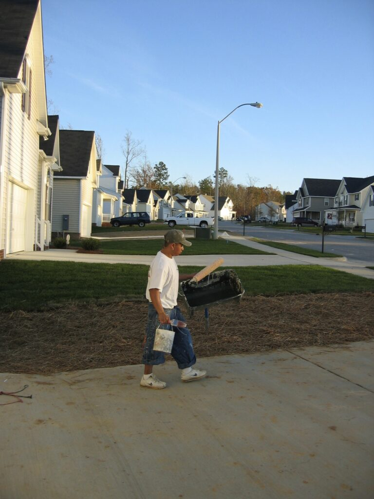 Enrique finishes a day of painting houses in North Carolina.[Credit: Sonia Nazario]