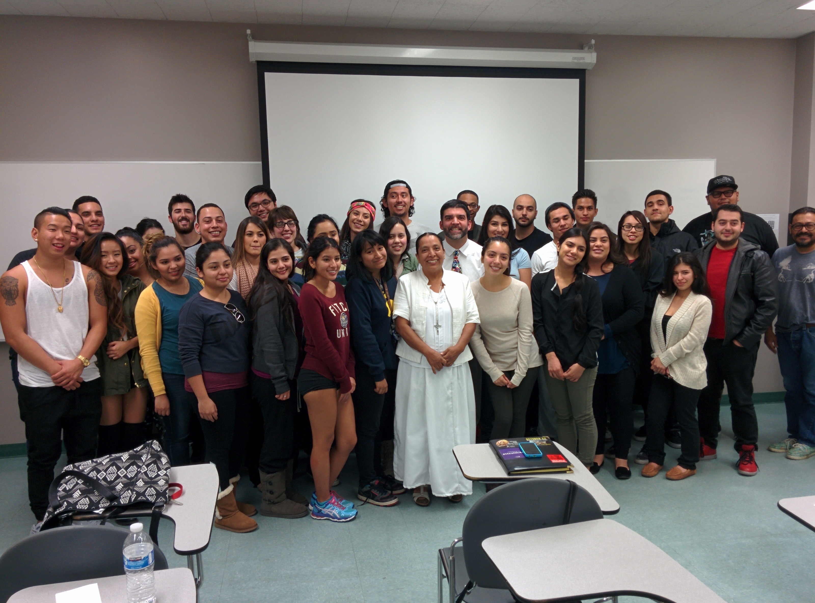 "Olga Sanchez Martinez (center, wearing white) visited a class at California State University, Northridge in November 2015. Olga runs a shelter that helps migrants hurt by the ""Death Train"" in Chiapas, Mexico. More information about her shelter Albergue Jesus el Buen Pastor is available by visiting http://www.alberguebuenpastor.org.mx/"