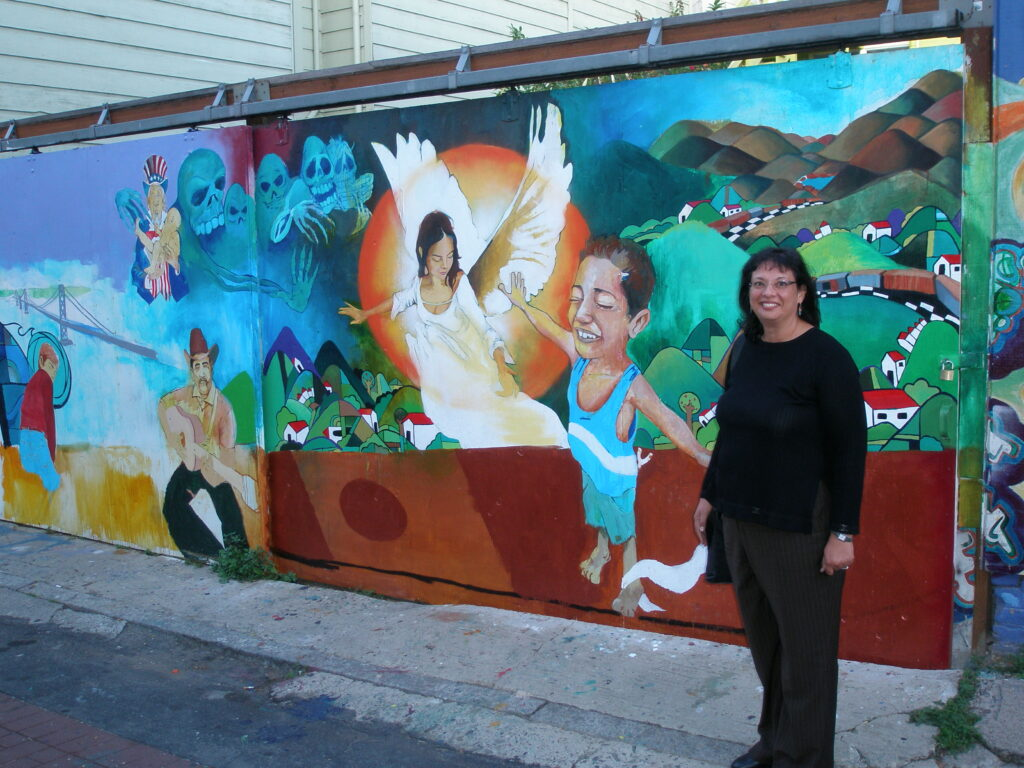 Sonia Nazario visiting Josue Rojas' mural in San Francisco's Balmy Alley.