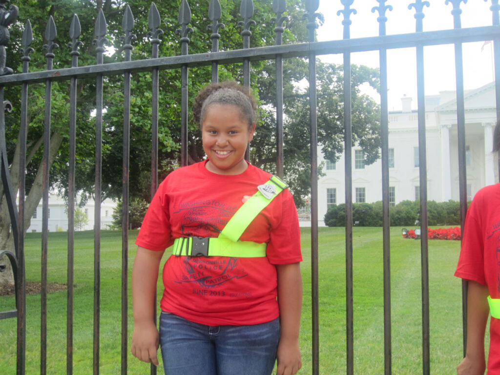 Jasmín stands in front of the White House in June, 2013. She was in Washington D.C. attending a conference for school safety volunteers.