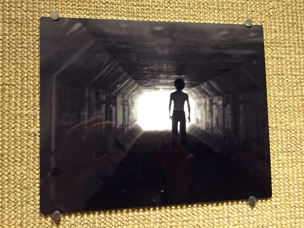 Photography work by Sam Houston State University student Autumn Dowdy. The piece intends to convey the emotional aspect of abandoned children searching for a future promise of belonging.