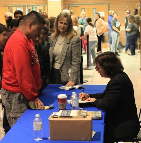 Sonia Nazario signs books for students at Norcross High School